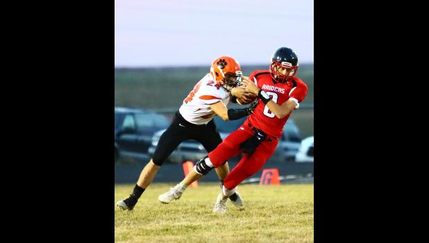 Philip's Lane Kroetch performs a solo tackle against this Lyman Raider ball carrier. Photo by Barb Hockenbary