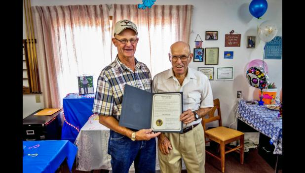 """Butch Feddersen presents Bob Totton with the Governor's Proclamation designating August 4, 2016 as """"Bob Totton Day."""""""