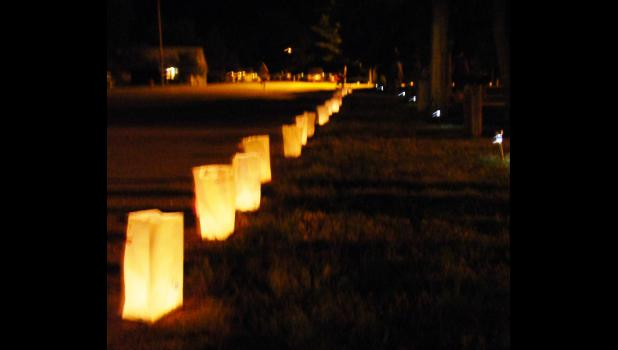 During a past Quad County ReLay For Life event in Philip, luminaries, representing survivors, those who have fallen and care givers, lined the path walked by individuals and teams.