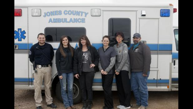 Five excited EMT students stop for a picture in front of the Jones County Ambulance after a successful morning of testing. Above (left) is instructor Heath Harter with students Rylee Metzger, Krisanna Thomas, Lacie Campbell, Vanessa Hight and Chris Letellier.