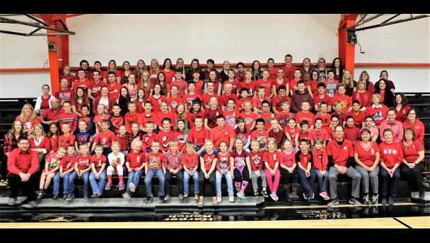 """Faith School celebrated Red Ribbon Week October 23 thru October 31, 2018, with theme dress up days during the four day school week. Everyone was encouraged to  join in the celebration and be active in saying no to drugs. Day one was """"Team Up Against"""" Drugs (wear a jersey); Day two - """"Build a Drug Free America (wear red, white & blue); Day three - """"Future is Too Bright for Drugs"""" (wear neon); Day four - Wear RED!  To celebrate the culmination of Red Ribbon Week, staff and students gathered in the school gy"""