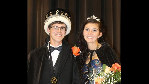 """The Philip High School coronation, Tuesday, Sept. 13, saw Kreid Amiotte crowned king and Peyton Kuchenbecker crowned queen. Kuchenbecker's first duties were to bless the school's cross country shoes, football and volleyball. Outside, Amiotte lit the Philip Scotties' huge """"P."""""""