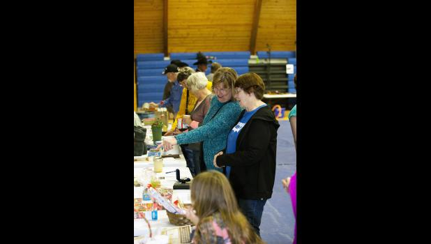 Photo by Barb Hockenbary. Local friends and family browse the tables showcasing hundreds of donated items to be auctioned at the event.
