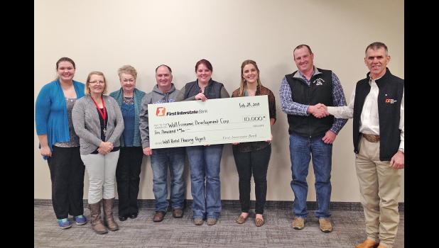 First Interstate Greater Wall Area Fund presents the Wall Economic Development Corporation Board of Directors with a $10,000 grant award for the Rental Housing Project. Pictured left to right, WEDC Board Members Mercede Hess, Carolynn Anderson, Mary Williams, Marty Huether, Dani Herring, WEDC Executive Director Cheyenne McGriff, WEDC Board Member Josh Geigle and First Interstate Greater Wall Area Fund President Brett Blasius. (WEDC Board Member present but not pictured, Kalie Kjerstad).