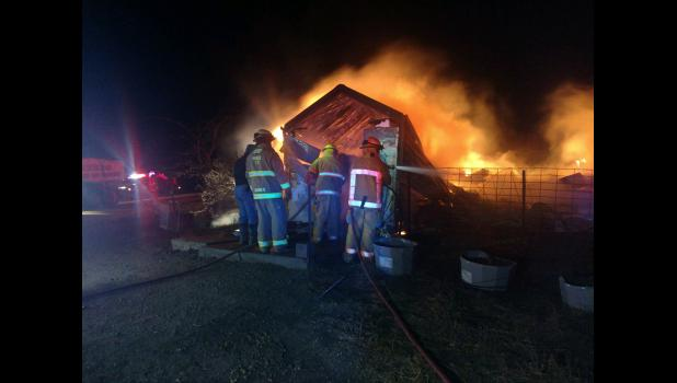 Members of the MurdoVolunteer Fire Department on scene of the fire.