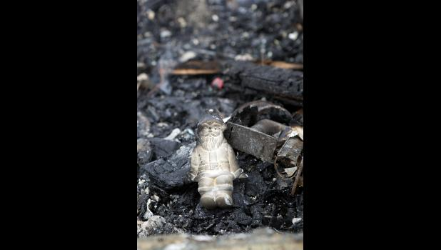 A Santa Claus figurine found amongst the ashes.